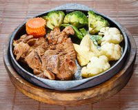 Juicy grilled pork chop (neck cut) with vegetables Stock Photos