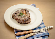Juicy grilled rib eye steak with cutlery Stock Photo
