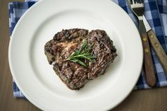 Juicy grilled rib eye steak with cutlery, top view Royalty Free Stock Photography