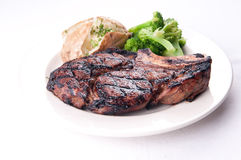 Juicy grilled rib steak Royalty Free Stock Photography