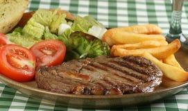 Rib eye steak wth fries Stock Images