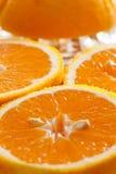 Juicy halved oranges as closeup Stock Photo