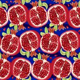 Juicy halves of pomegranate on blue background. Pattern. Vector illustration. Vector seamless pattern with ripe halves of pomegranate on bright blue background Royalty Free Stock Images