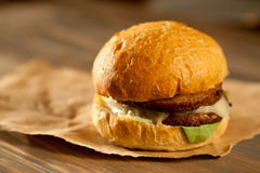 Juicy Hamburger. On paper wrapping Stock Photography