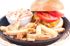Juicy hamburger, hand cut fries and cole slaw Royalty Free Stock Photo