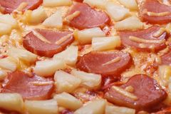 Juicy Hawaiian pizza with pineapple and ham background macro Stock Image