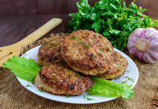 Juicy homemade cutlets  on a wooden backgro Royalty Free Stock Photography
