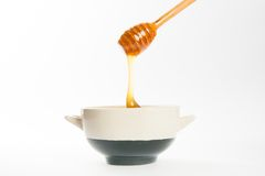 Juicy honey in a cup and spoon Stock Images