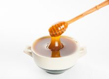 Juicy honey in a cup and spoon Stock Photos