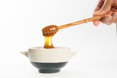 Juicy honey in a cup and spoon Royalty Free Stock Images