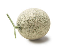 A juicy honeydew melon from Japan on a white background. Royalty Free Stock Photos