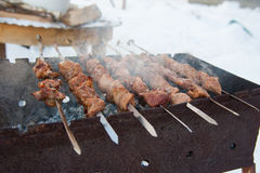 Juicy kebabs on the grill Royalty Free Stock Images