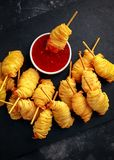 Juicy king prawns wrapped in little spirals of crisp, golden potato on skewers served with sweet chillie sauce. Juicy king prawns wrapped in little spirals of Royalty Free Stock Photo