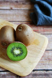 Juicy kiwi on  chopping board Stock Image
