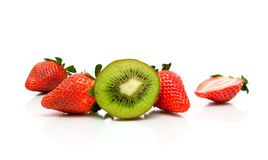 Juicy kiwi and fresh strawberries on a white background. Royalty Free Stock Photography