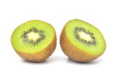 Juicy Kiwi fruit cut in half Royalty Free Stock Images