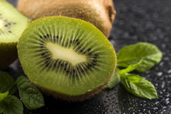 Juicy kiwi fruit and freas mint leaves Royalty Free Stock Photos