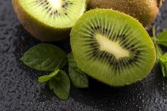 Juicy kiwi fruit and freas mint leaves Stock Photo