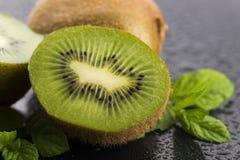 Juicy kiwi fruit and freas mint leaves Stock Photos