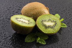 Juicy kiwi fruit and freas mint leaves Royalty Free Stock Photography