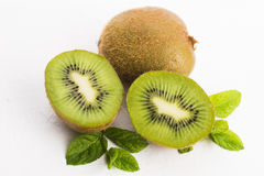 Juicy kiwi fruit and freas mint leaves Stock Images