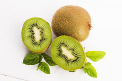 Juicy kiwi fruit and freas mint leaves Stock Photos
