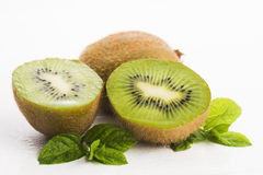 Juicy kiwi fruit and freas mint leaves Royalty Free Stock Photo
