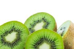 Juicy kiwi fruit isolated on white background. Whole kiwi fruit and his sliced segments isolated on white background Royalty Free Stock Image