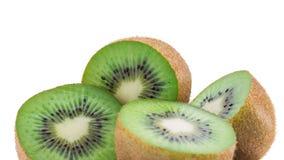 Juicy kiwi fruit isolated on white background. Whole kiwi fruit and his sliced segments isolated on white background Royalty Free Stock Photos
