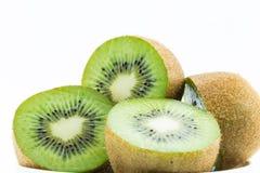 Juicy kiwi fruit isolated on white background. Whole kiwi fruit and his sliced segments isolated on white background Stock Photos