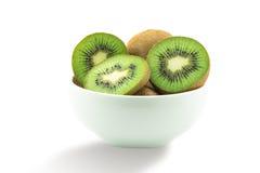 Juicy kiwi fruit isolated on white background. Whole kiwi fruit and his sliced segments isolated on white background Royalty Free Stock Images