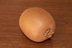 Juicy kiwi fruit. Juicy kiwi fruit isolated on wood Royalty Free Stock Images