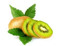 Juicy kiwi fruit and leaves Stock Photography