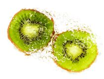 Juicy kiwi fruit in water on a white background. macro Stock Photography