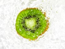Juicy kiwi fruit in water on a white background. macro Royalty Free Stock Images