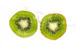Juicy kiwi fruit in water on a white background. macro Royalty Free Stock Photo