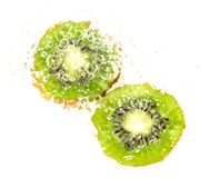 Juicy kiwi fruit in water on a white background. macro Stock Photo