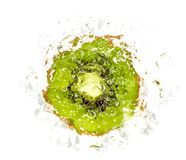 Juicy kiwi fruit in water on a white background. macro Stock Photos