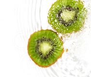 Juicy kiwi fruit in water on a white background. macro Stock Images