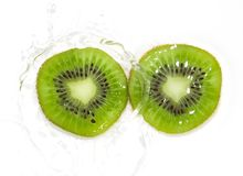 Juicy kiwi fruit in water on a white background. macro Stock Image