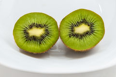 Juicy kiwi fruit. On a white plate Royalty Free Stock Images