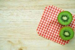 Juicy kiwi fruit on wooden table Stock Photo
