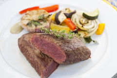 Juicy lamb loin with summer vegetables Stock Images
