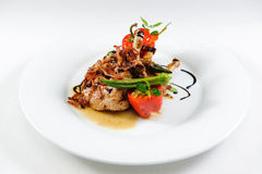Juicy lamb steak with vegetables Stock Photos