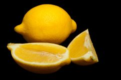 Juicy lemon with lemon slice Stock Photo