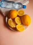 Juicy lemons on pink background Stock Photography