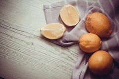 Juicy lemons on wooden background Royalty Free Stock Photo