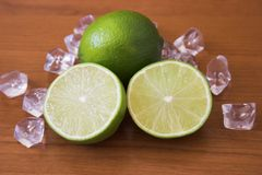 Juicy limes. Sliced & whole limes Royalty Free Stock Images