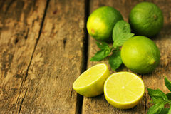 Juicy limes and fresh mint Royalty Free Stock Image