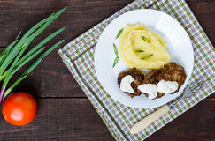 Juicy liver cutlet with sauce and mashed potatoes on a white plate. Royalty Free Stock Photography